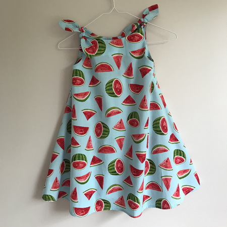 Girls Swing Dress: Blue b/g Watermelon design. Bows on shoulders. - SIZE 5