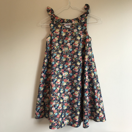 Girls Swing Dress: Navy floral design with bows on shoulders. - SIZE 7