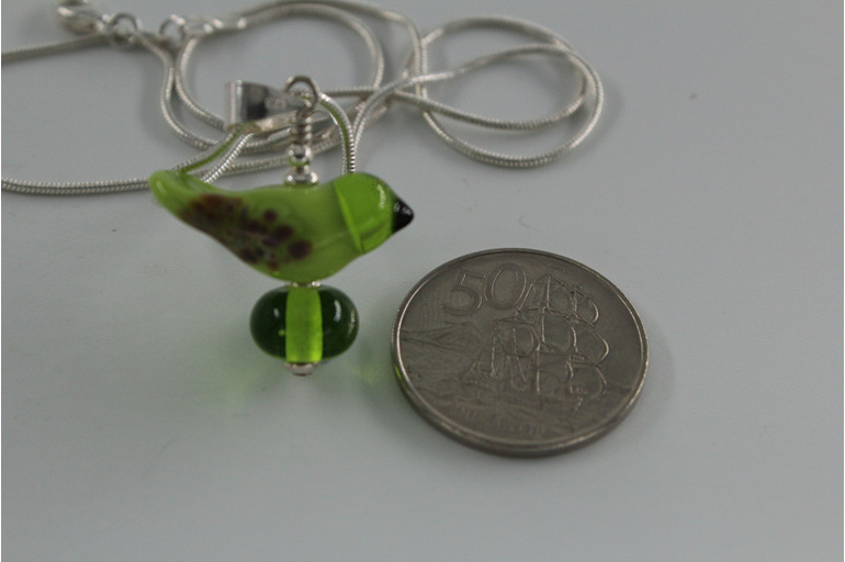 Glass bird pendant - green with NZ 50 cent piece for size reference