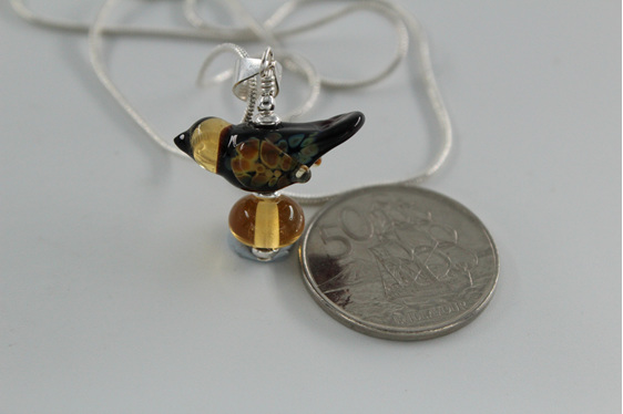 Glass bird pendant in brown and straw with NZ 50 cent piece for size reference