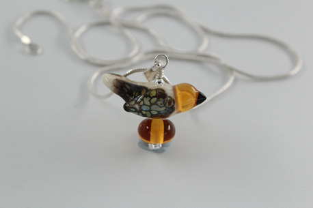 Glass bird pendant - ivory and amber