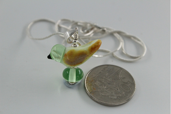 Glass bird pendant - pale green with NZ 50 cent piece for size reference