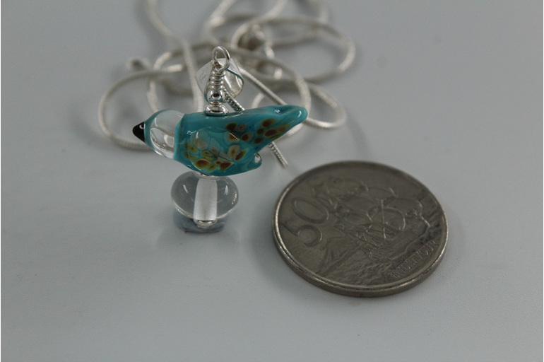 Glass bird pendant - sky blue with NZ 50 cent piece for size reference