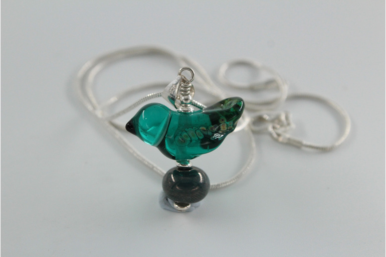 Glass bird pendant - teal green