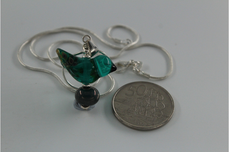 Glass bird pendant - teal green with NZ 50 cent piece for size reference