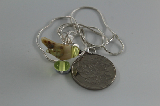 Glass bird pendant - yellow opal with NZ 50 cent piece for size reference