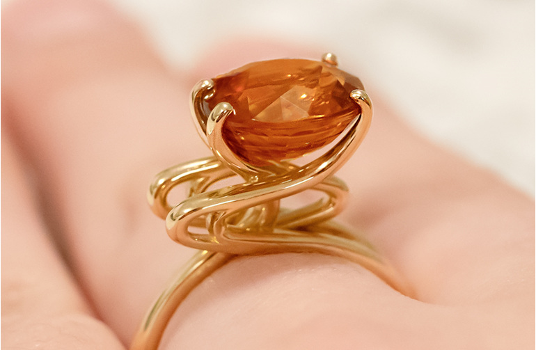 Golden Zircon Ring on Hand