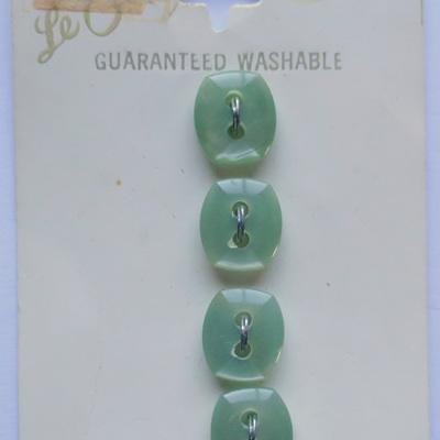 Tiny pale green buttons