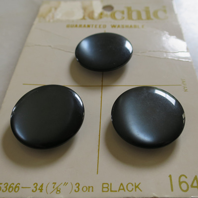 Dome buttons with a sheen