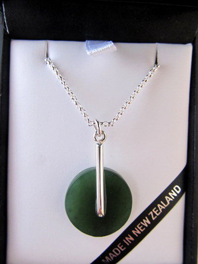 GS1104 Round greenstone pendant with silver post and chain.