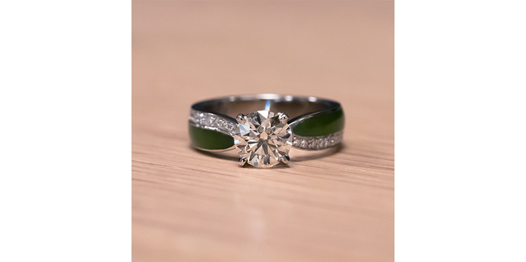 Hand carved pounamu and diamond engagement ring