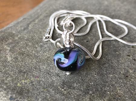 Handmade glass pendant - cosmic swirl - Pale blue/purple