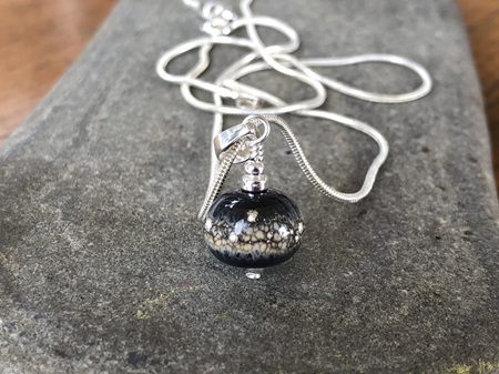 Handmade glass pendant - pure silver trails - sandstone on black