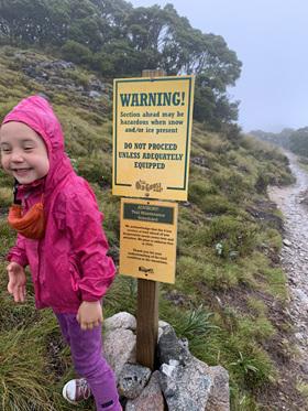 happy in the rain kids hiking