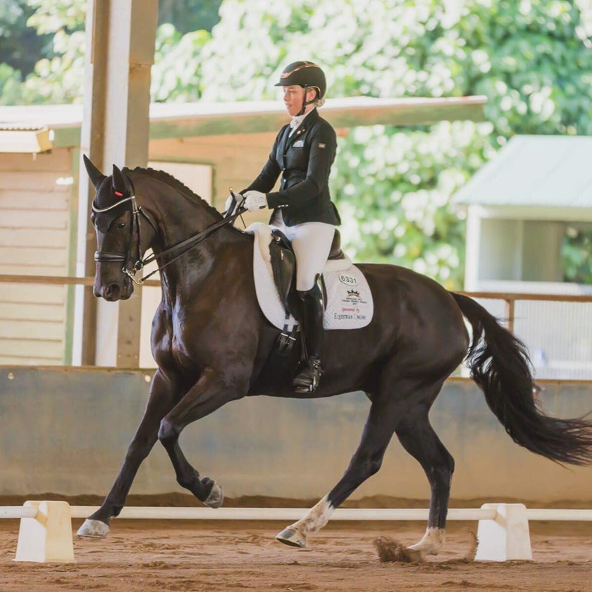 Hope Beerling with Aussie performing Dressage