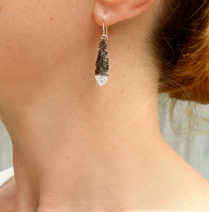 huia feather black white sterling silver dangle earrings worn koru