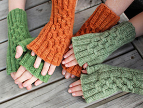 image is of 3 pairs of hands wearing fingerless mittens in green and orange