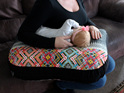 Image of a mother breastfeeding her baby on a BABYBABY nursing pillow