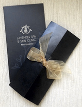 image of lavender spa voucher wrapped with a bow