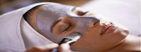 image of woman having a face mask applied