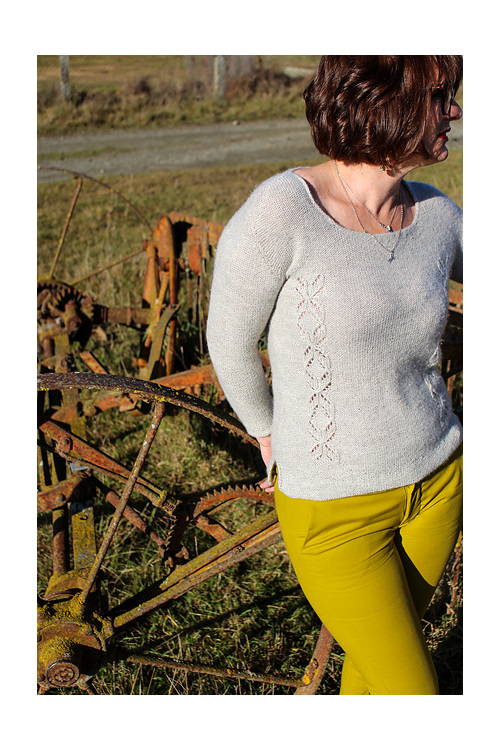 Image shows a female wearing a light coloured sweater with lace panels