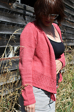 image shows a female wearing a pink/red waterfall cardigan, one hand by her side