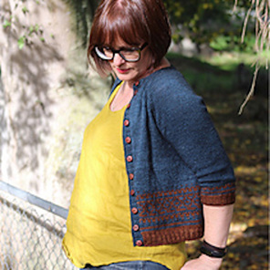 image shows a female wearing a yellow top with a blue and rust knit cardigan