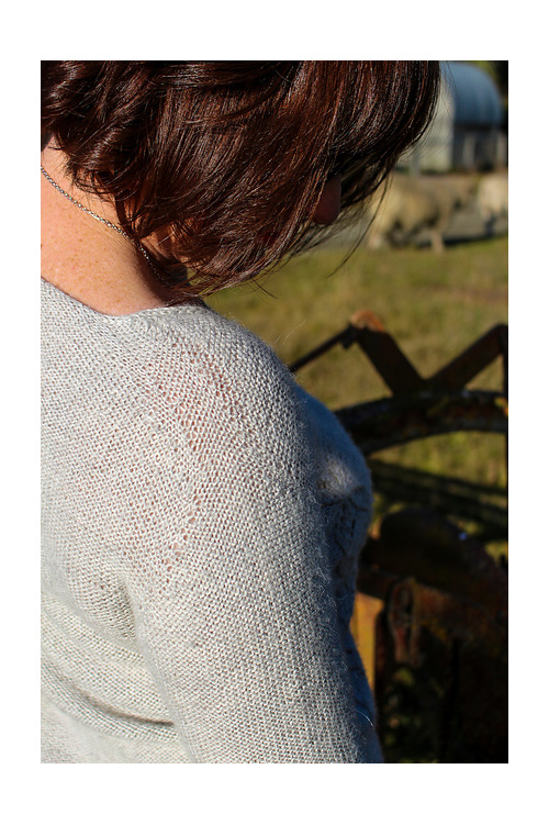image shows the shoulder seam of a knitted garment
