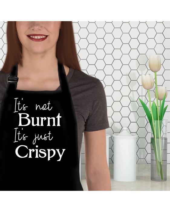 It's not burnt it's crispy funny apron