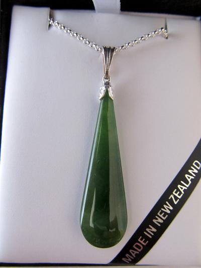 JP101S Drop-shaped greenstone pendant set in silver.