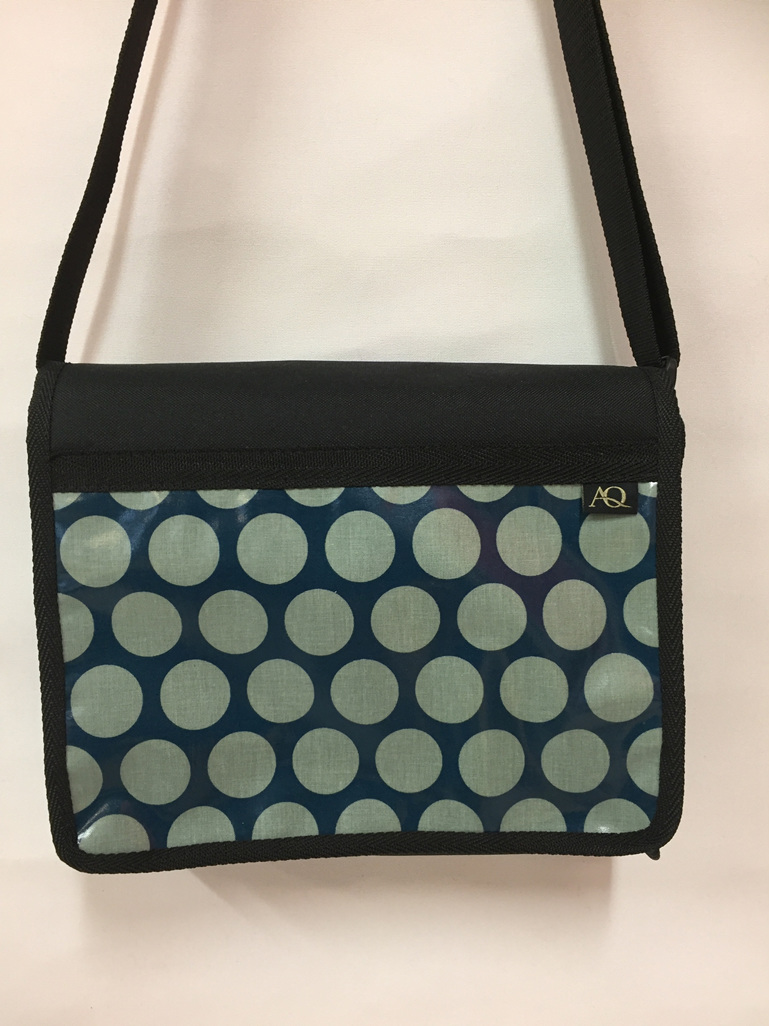 Kiwa satchel bag with teal dots.  A designer fabric to suit all women.