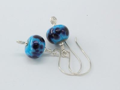 Koru earrings - Violet storm on turquoise