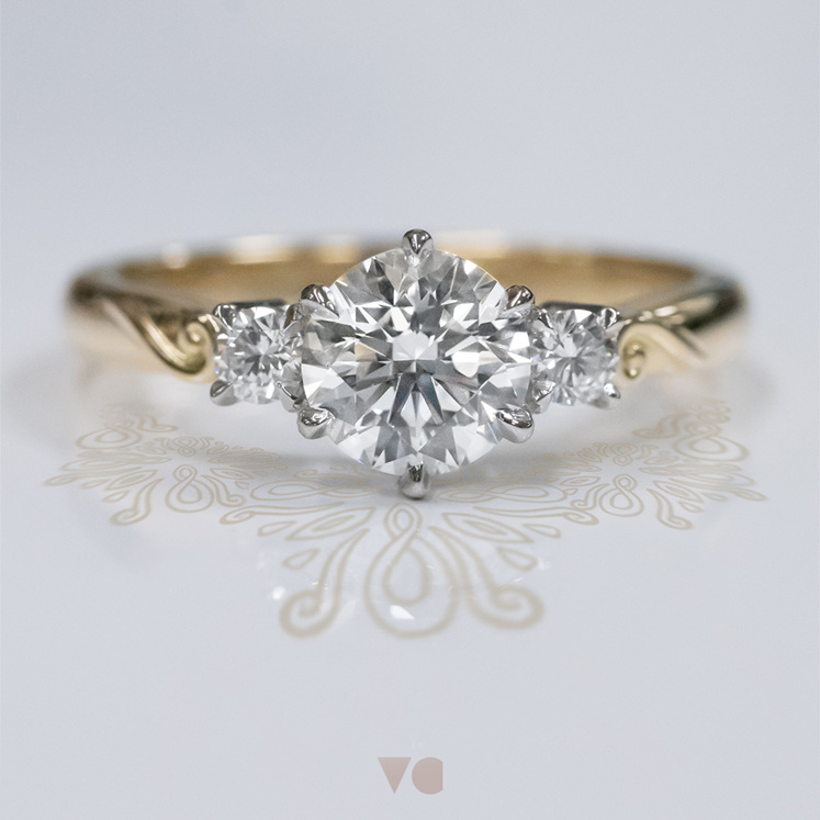 koru motif 18ct yellow gold platinum three stone diamond engagement ring