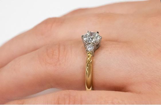 Koru motif band diamond three stone engagement ring yellow gold platinum