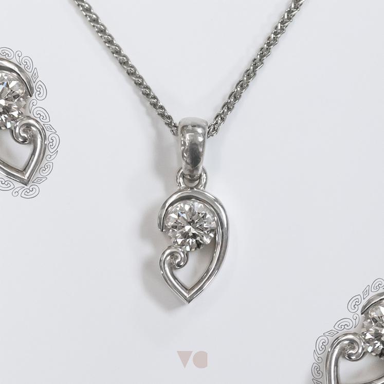 koru motif detail diamond solitaire pendant unique necklace nz maori culture