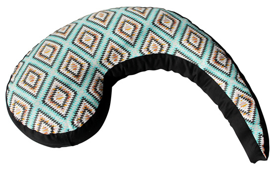 Koru shaped nursing pillow with vibrent mint aztec designs over it
