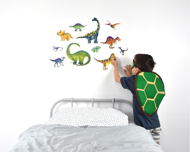 Large dinosaur wall decal with child applying it to the wall