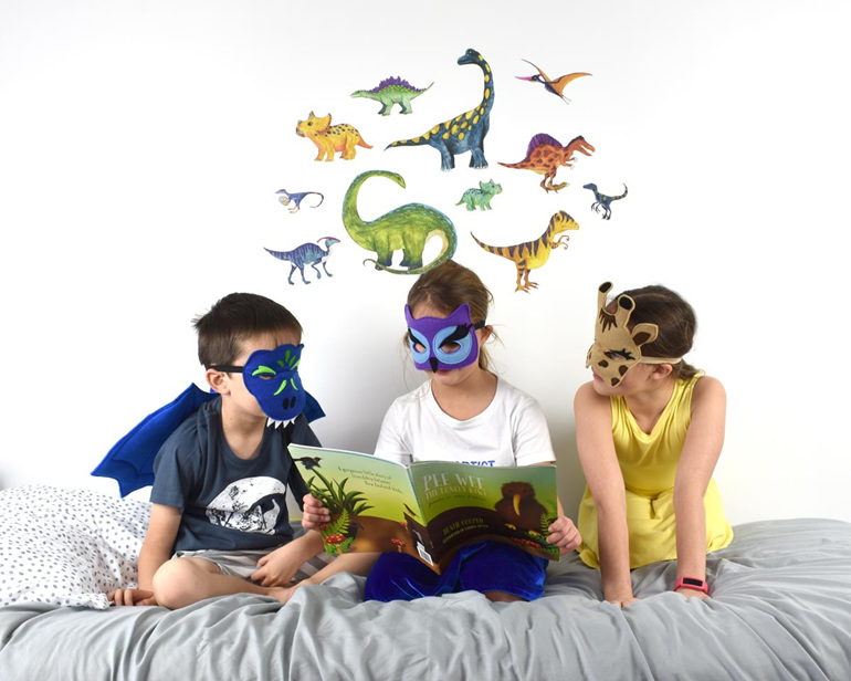 Large dinosaur wall decal with children reading a book