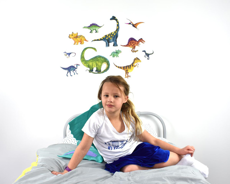 Large dinosaur wall decal with girl sitting on bed