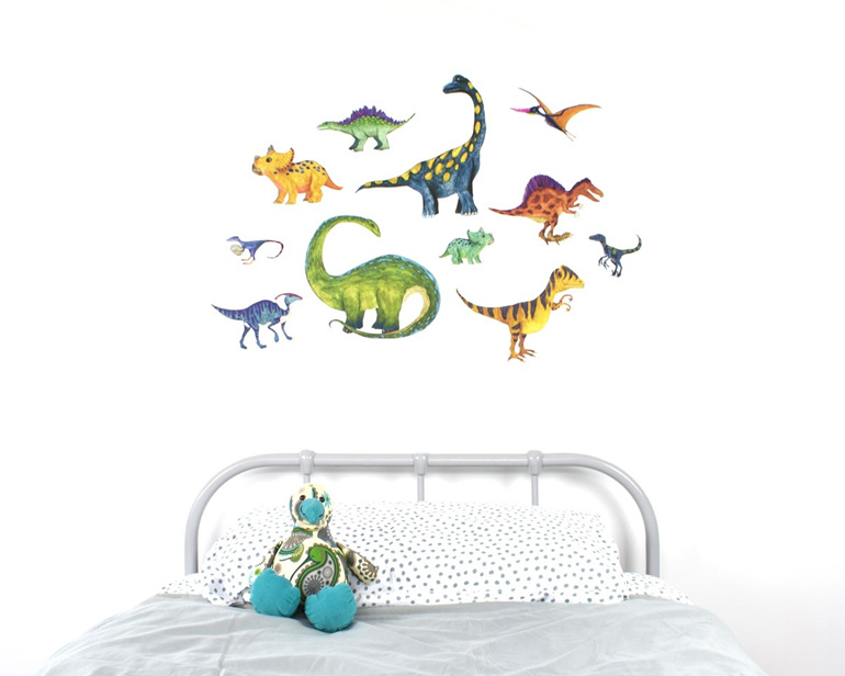 Large dinosaur wall decal with kiwi soft toy on bed