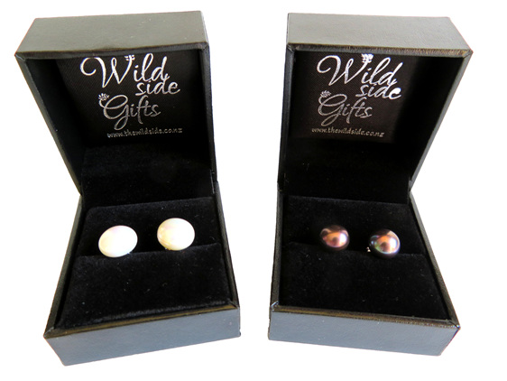 Large freshwater pearl stud earrings in white and black.