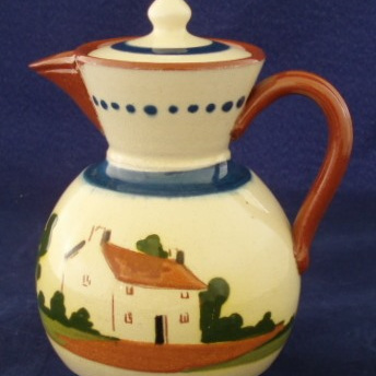 Lidded pot motto ware