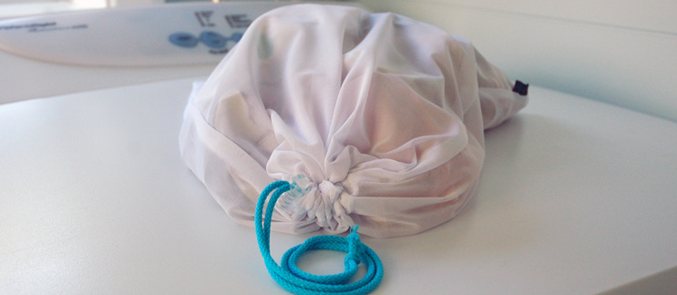 lingerie pouch on top of washing machine