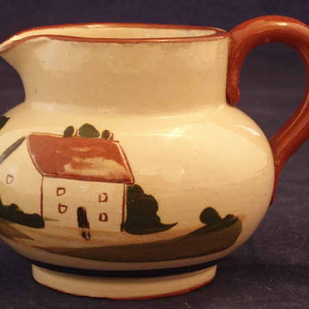 """Little cream jug """"early sow early mow"""" motto"""