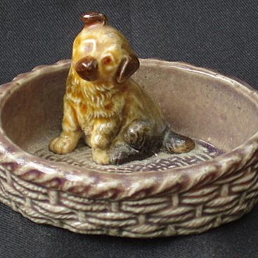 Little dog in a basket