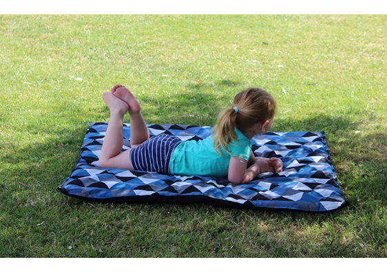little girl relaxing on a babybaby padded play mat