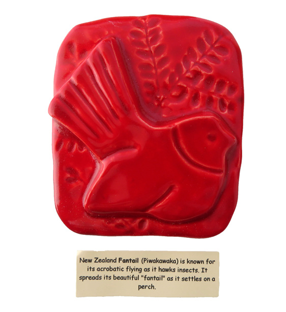 Little red ceramic tile of a Fantail