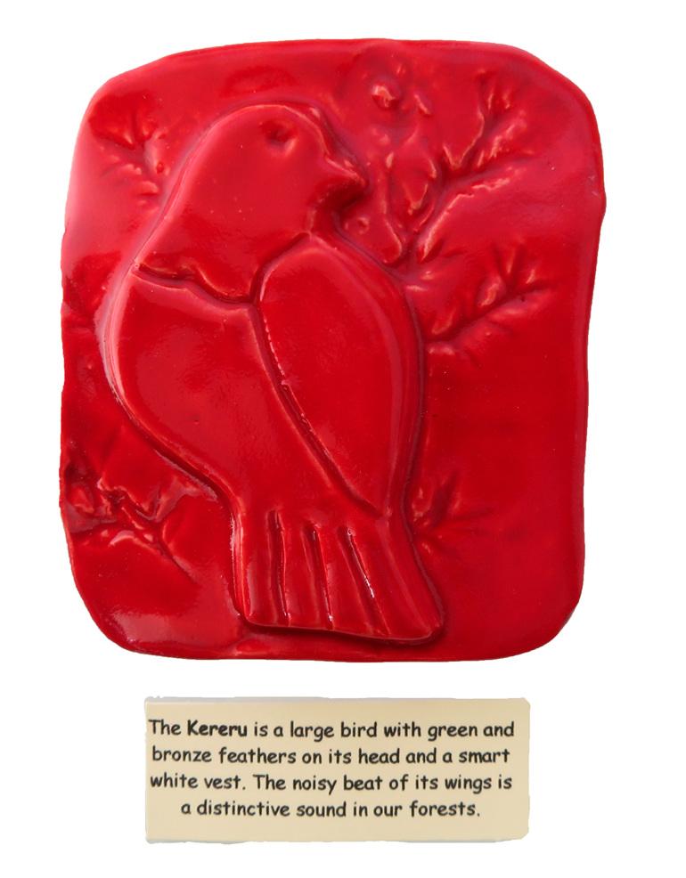 Little red ceramic tile of a Kereru bird