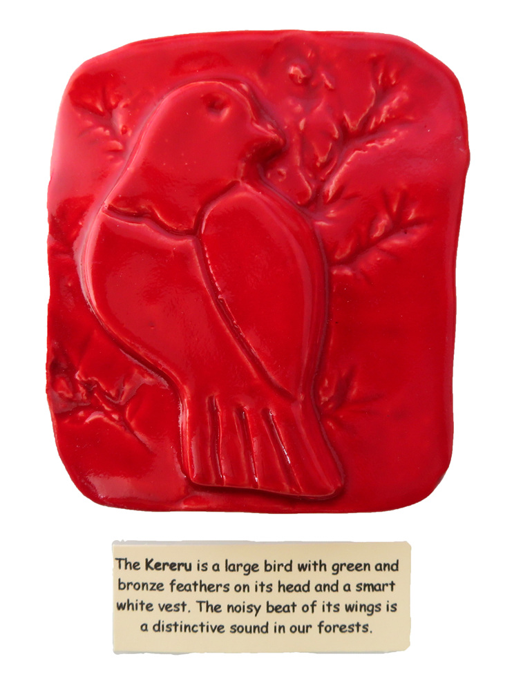 Little red ceramic tile of a Kereru bird