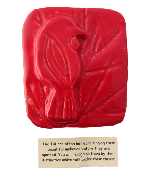Little red ceramic tile of a Tui bird